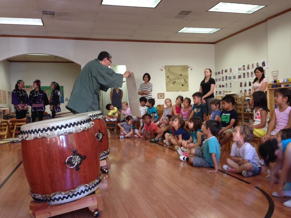 Tatsu Aoki teaching Japanese drumming to children